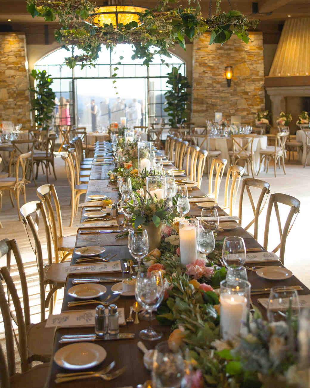 this rustic farm table seated the wedding party, and featured pink and peach flowers