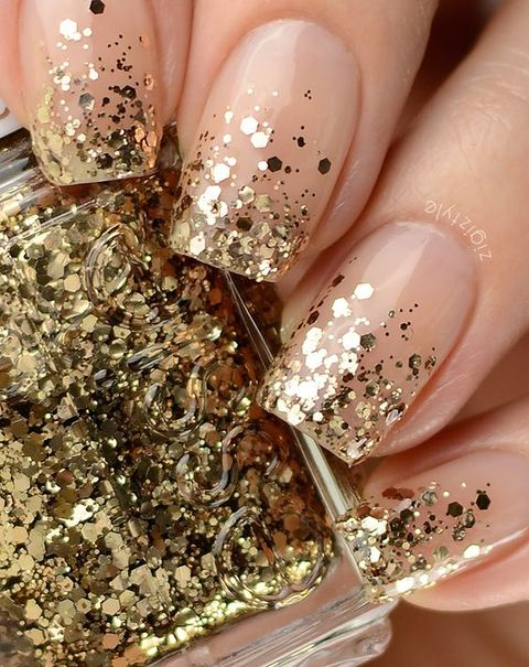 a French manicure with gold glitter touches is a lovely idea for a modern glam bride and a fresh take on traditional