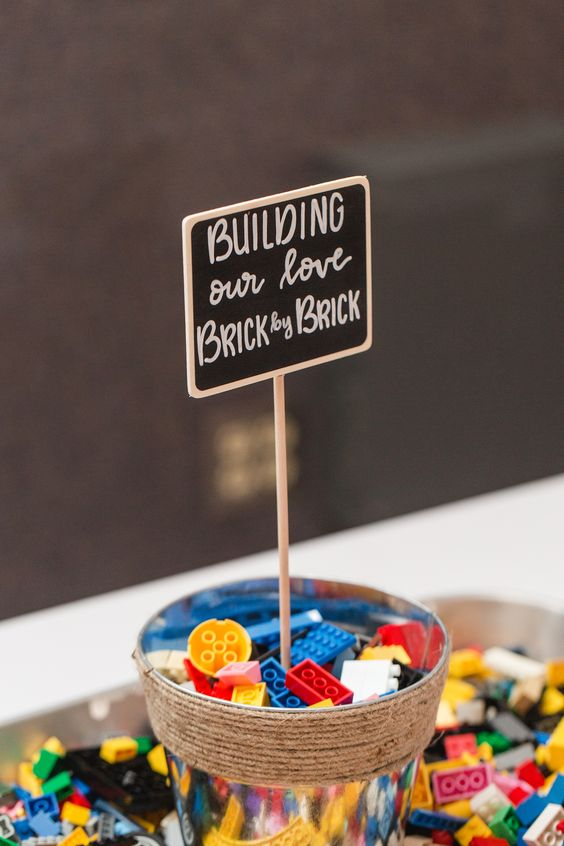 a Lego station is a nice idea for a kid-friendly wedding or a cool wedding favor idea
