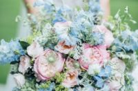 a beautiful and textural pink and blue wedding bouquet with plenty of greenery for texture is a cool idea