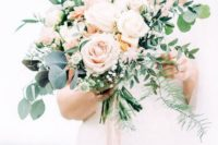 a beautiful blush and cream rose wedding bouquet with textural greenery for a neutral-colored wedding