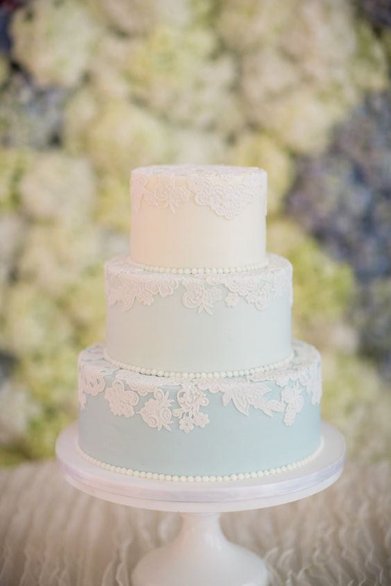 a blue and white wedding cake decorated with lace flowers and edible beads is very cute and ideal for spring or summer