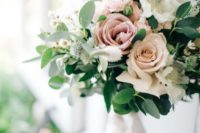a blush, dusty pink and white rose bouquet with greenery for a spring wedding
