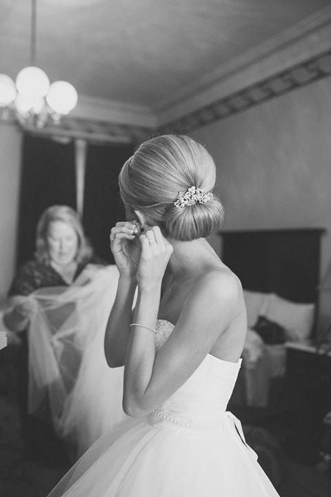 a chic vintage wedding hairstyle with a volume on top and a chignon plus a shiny hairpiece