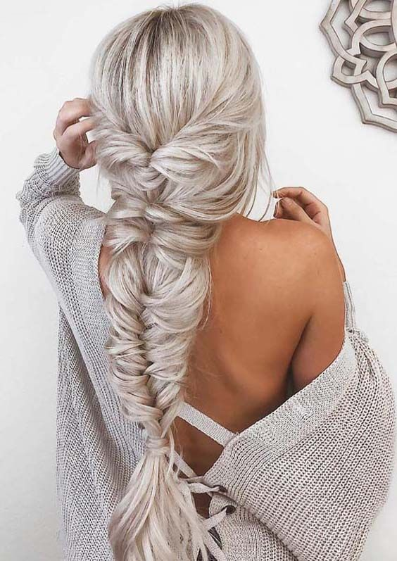 a dimensional fishtail braid with twists in icy blonde is a beautiful and chic idea with a boho feel