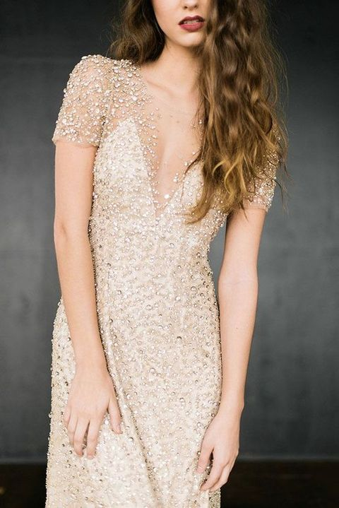 a fitting glitter wedding dress with a covered plunging neckline, short sleeves is amazing for a shiny holiday or just glam wedding