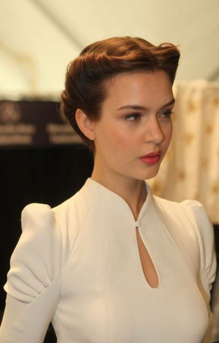 a fresh take on classics   an updo with twisted hair on both sides of the head