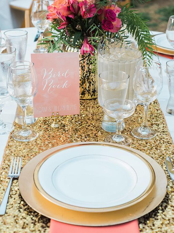 a gold glitter wedding table runner, gold chargers and gold rimmed plates plus a gold vase are lovely for a modern glam wedding