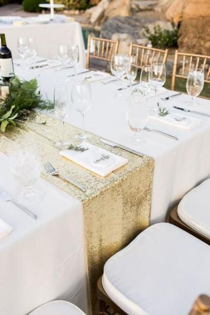 a gold sequin table runner is always a great glam idea for a wedding tablescape, it pairs up with greenery in a beautiful way