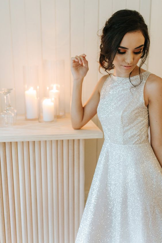 a gorgeous A-line sleeveless white glitter wedding dress is a stylish and very glam idea for a modern refined bride