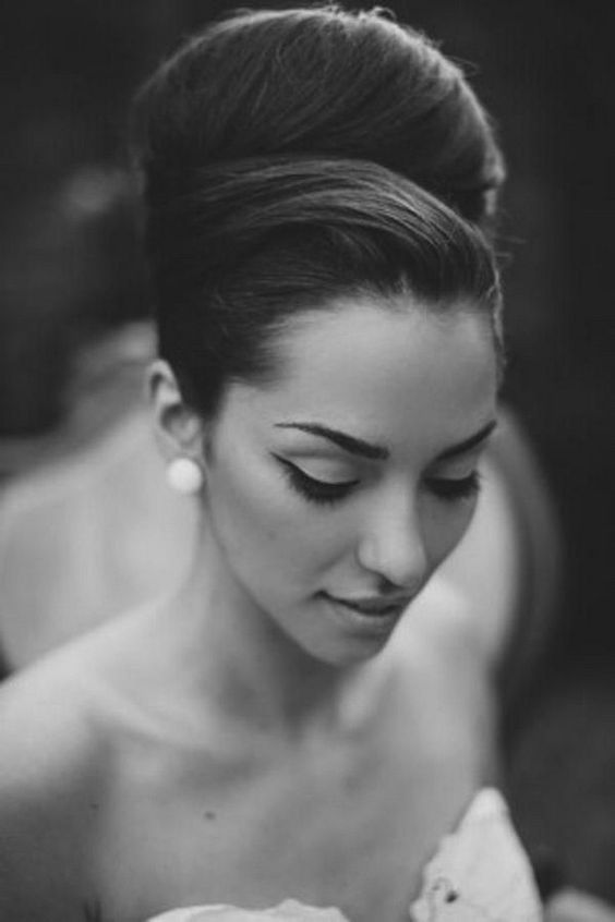 a large top knot with a twisted top is an elegant and very chic option for a vintage inspired bridal look