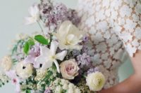 a lilac, white and blush wedding bouquet with plenty of greenery and texture for a spring wedding