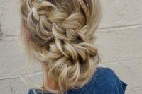 a low bun with a side dimensional braid that forms a bun is a cute boho idea