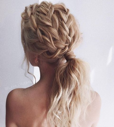 a low ponytail with fully braided top and some locks down is a very fresh and modern idea