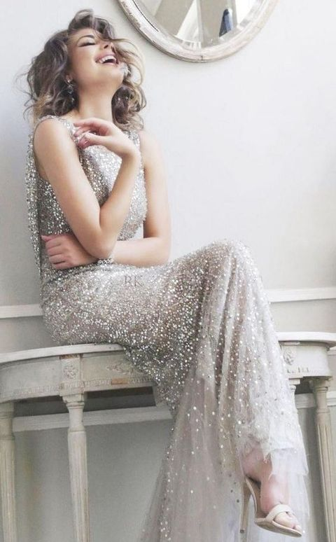 a maxi silver glitter wedding dress with a high neckline and no sleeves, statement earrings and nude heels for a gorgeous glam look