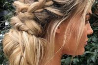 a messy low bun with a textural bump and braids on two sides plus hair down is a casual idea