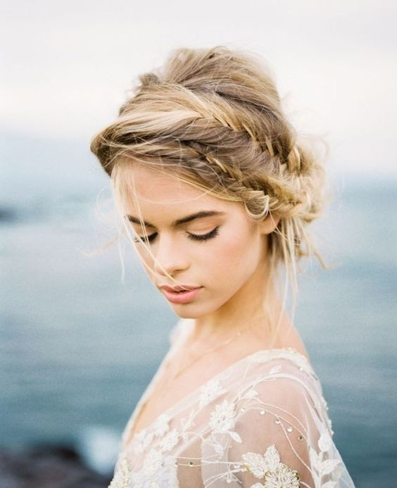 a messy low updo with a double fishtail braid and some hair down is a romantic idea