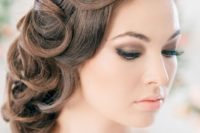 a retro-inspired curled side updo on long hair with fixed curls is a unique take on a traditional hairstyle