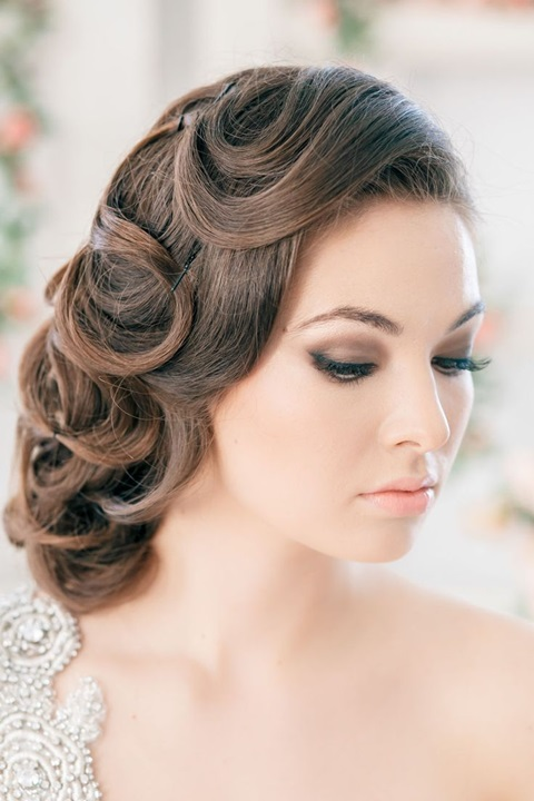 a retro inspired curled side updo on long hair with fixed curls is a unique take on a traditional hairstyle