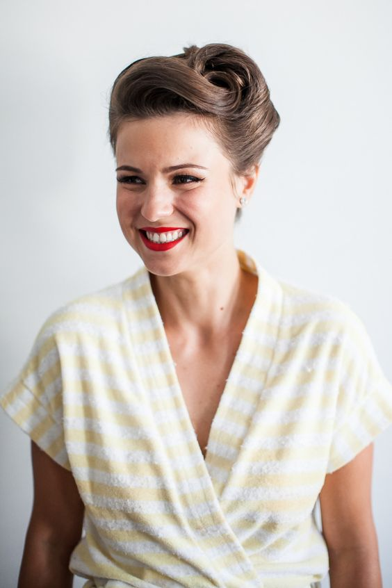 a retro inspired curled updo with a fixed voluminous top will fit a 1940s or 1950s wedding
