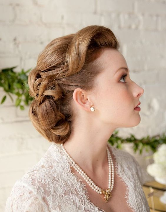 a retro wedding updo with fixed waves and curls on long hair is a very cool idea for a 1940s or 1950s wedding