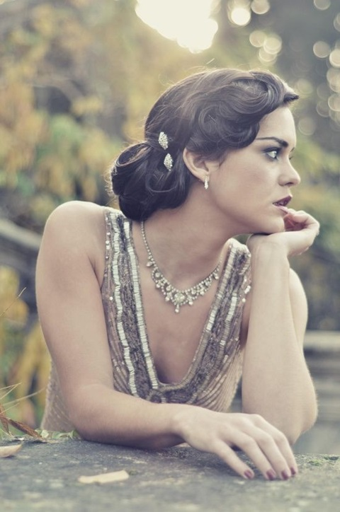 a side updo with fixed curls and a shiny hairpiece is a gorgeous idea for a 1920s or 1930s wedding