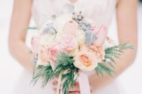 a sweet light pink and blush wedding bouquet with pale millet and some greenery is amazing