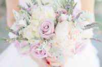 a sweet pastel bouquet of white and dusty pink roses and some herbs looks cool and very romantic