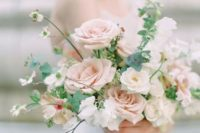 a tender blush nd neutral wedding bouquet with textural greenery is perfect for a romantic spring bride