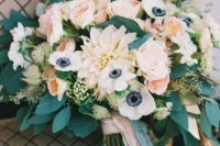 a tender peachy wedding bouquet with some neutral blooms and lots of greenery for texture