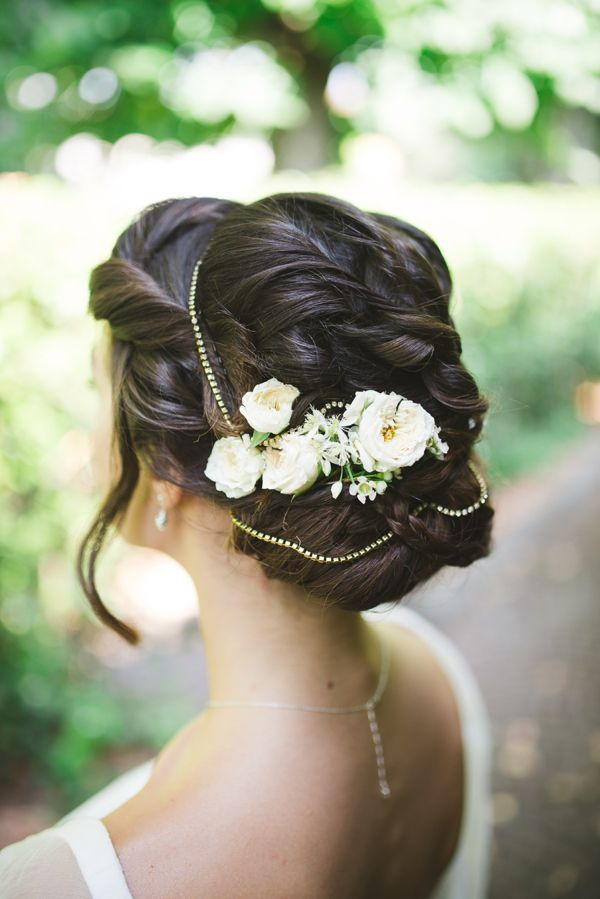 a vintage inspired twisted and wavy updo with some locks down, beads and fresh flowers and greenery