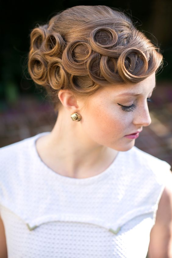 a vintage wedding updo with fixed curls on one side is a cool statement that will help you pull off the look