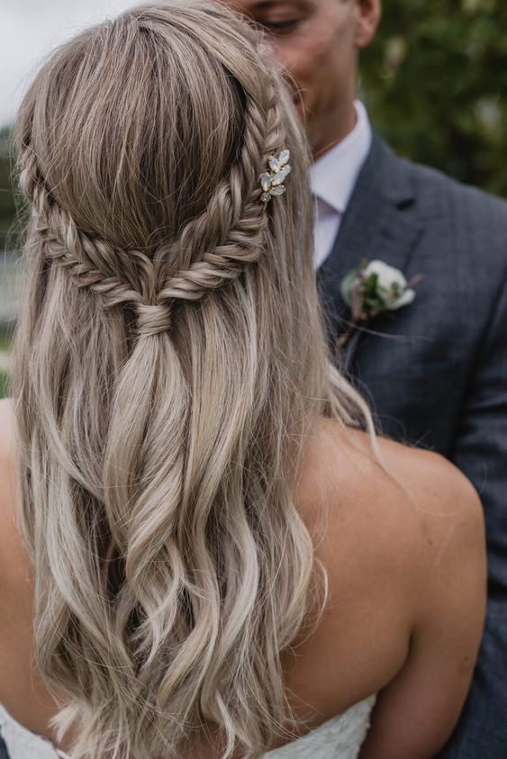 a wavy half updo with braids and a tiny embellished hairpiece is a very dreamy and chic idea
