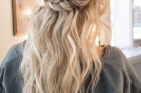 a wavy texturla half updo with a double braided halo and a bump for a boho bride