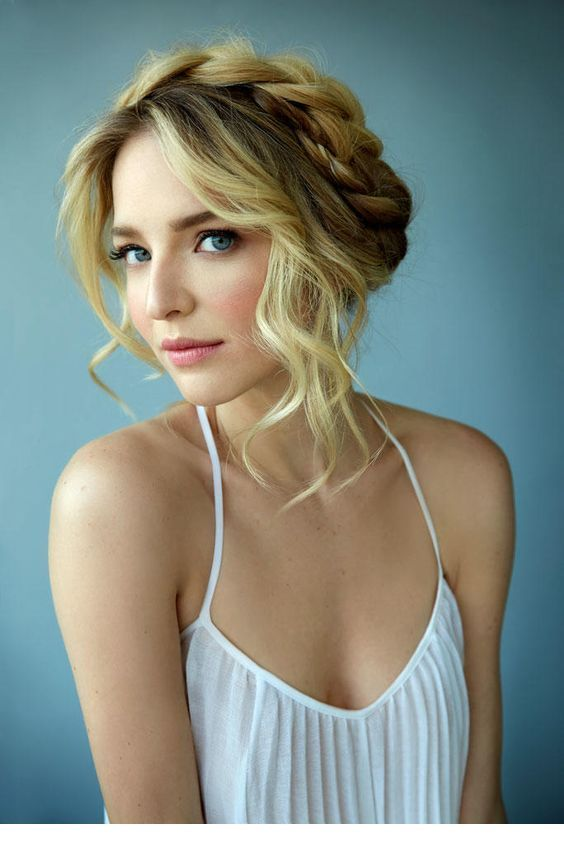 a wavy updo with a braided halo is a chic and timeless idea for a boho, rustic or just romantic bride