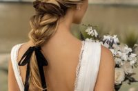 an elegant twisted braid with wavy ends and a black ribbon for an accent – it's a hot and trendy idea