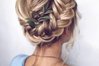 an updo with a bump and a dimensional side braid plus some locks down is a chic idea