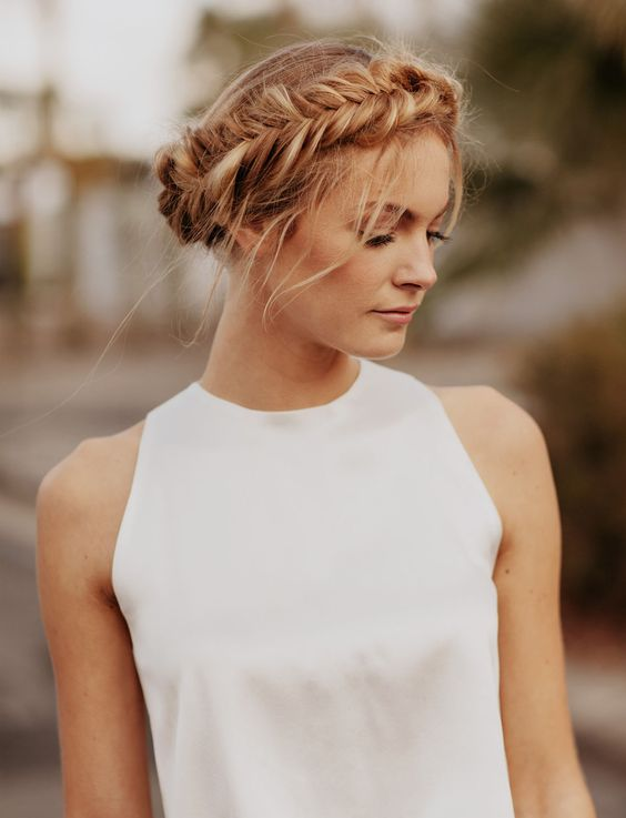 an updo with a fishtail braid on the side and some locks down is a modern and simple idea
