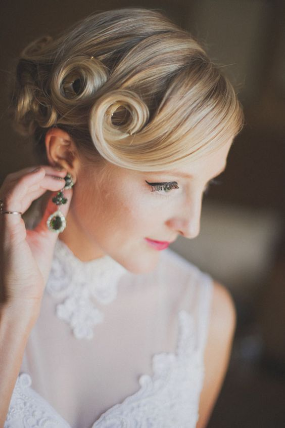 an updo with fixed curls on medium length hair and a curled side bang is a cool idea