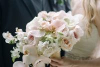 blush roses and peonies and white orchids for a beautiful cascading bouquet with a tropical feel
