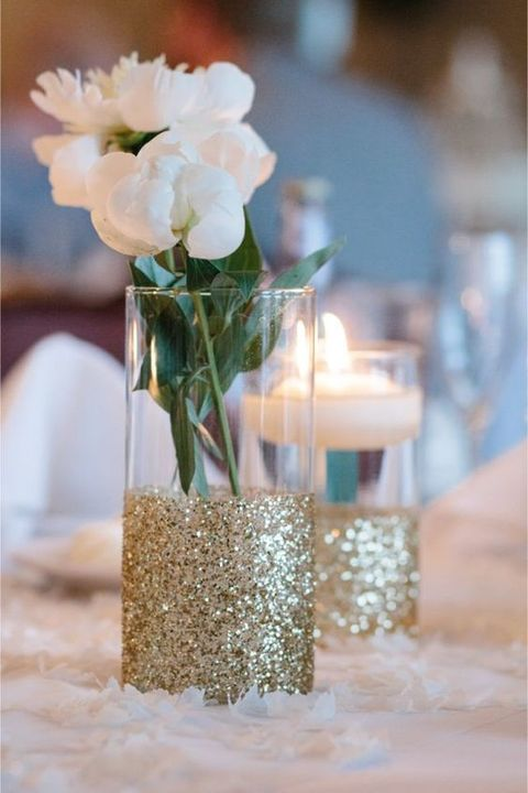 vases and candleholders accented with gold glitter will give a shiny touch and a cool look to your wedding reception table