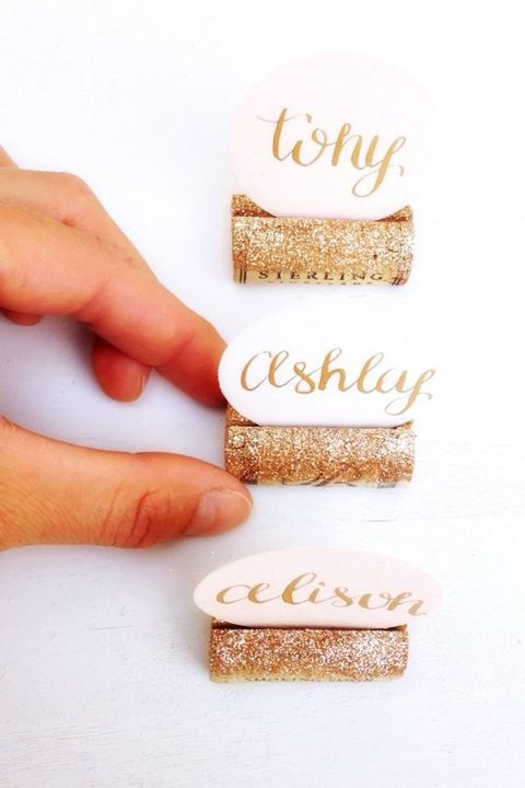 wine corks with gold glitter will be great card holders and such a project is very easy to DIY in a couple of minutes