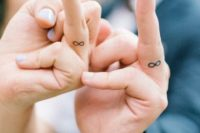 Infinity signs are done on the sides of your fingers are timeless