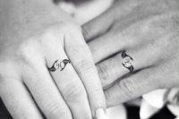 Stylish wedding ring imitating tattoos with a monogram of your partner