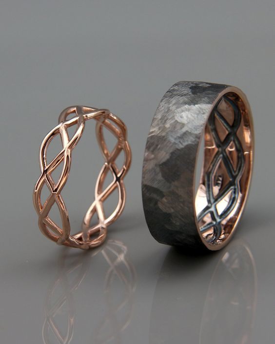 a black and a rose gold ring that is engraved in the inner part of the black one to show you two as a couple
