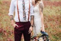 a boho groom's look with a white shirt, a floral tie, burgundy pants, amber leather suspenders for summer
