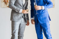 a bold blue three-piece wedding suit with cropped pants, a white shirt and white sneakers for a modern and bright look