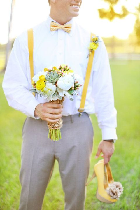 a bold spring groom's look with a white shirt, a yellow printed bow tie and matching suspenders plus grey pants
