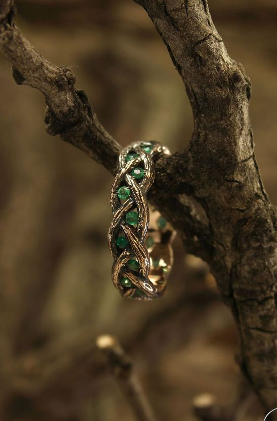 a branch inspired wedding ring with emeralds for geek couples and those who like elves