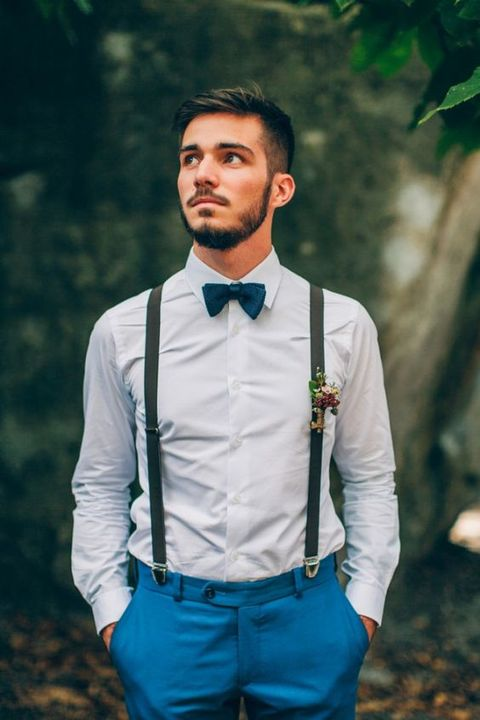 a bright outfit with bold blue pants, a white shirt, black suspenders, a teal bow tie for summer